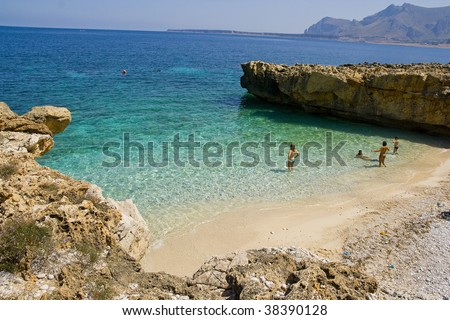 Family on the beach - San vito lo capo, sicily - stock photo