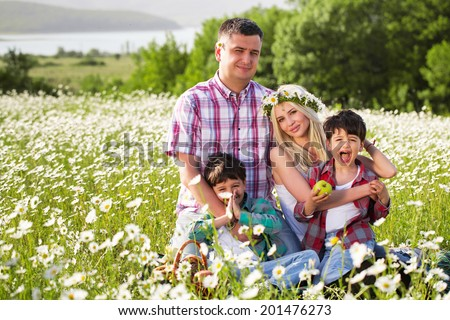 Family on the camomile meadow