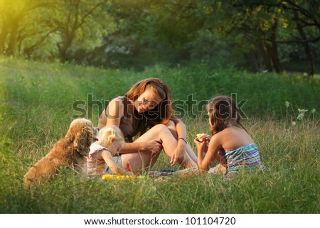 family on the picnic at the forest - stock photo