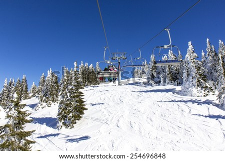 Family on the ski lift - stock photo