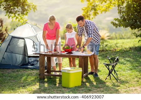 Family on vacation having barbecue in nature