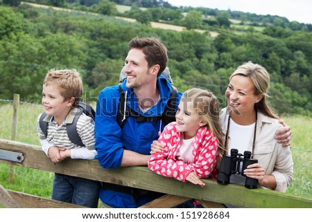 Family On Walk In Countryside - stock photo
