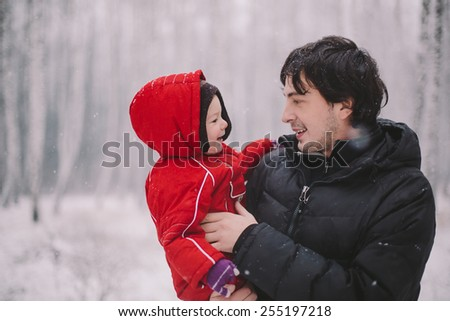 Family on winter background - stock photo