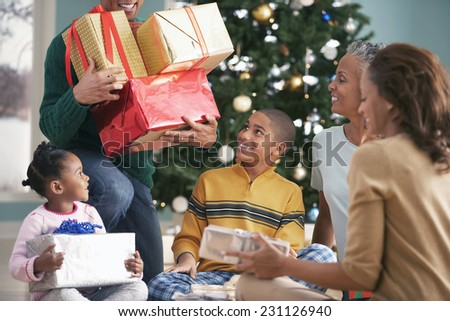 Family Opening Christmas Presents - stock photo