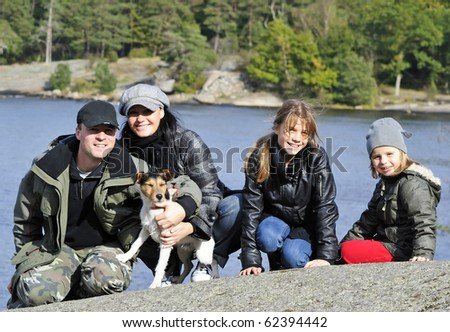 Family outdoor portrait on the sea coast - stock photo