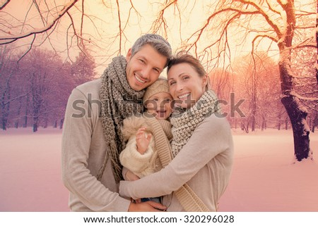 family outdoors in winter landscape - stock photo