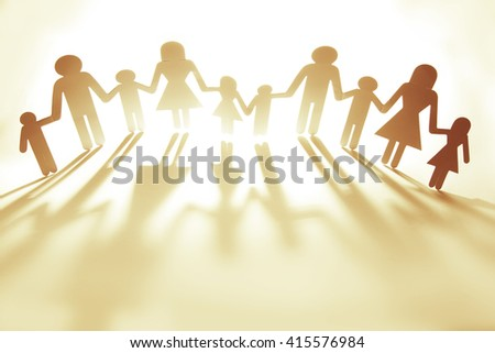 Family paper chain cutout holding hands - stock photo