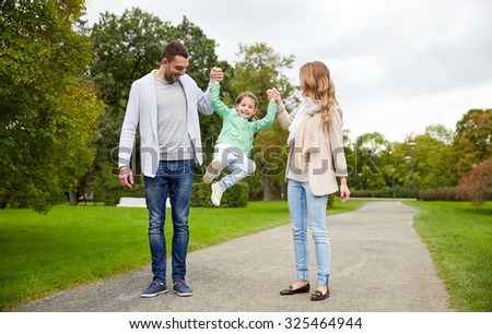 family, parenthood, adoption and people concept - happy mother, father and little girl walking in summer park and having fun - stock photo