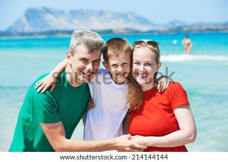 Family. Parents with child at sea beach - stock photo
