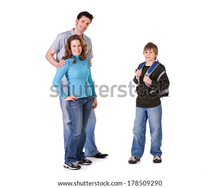 Family: Parents with Student Ready For School - stock photo