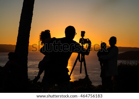 Family photo at sunset, in silhouette