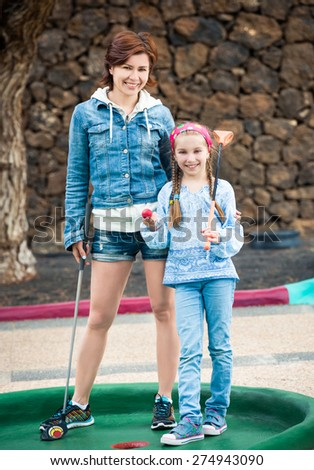 Family photo. Mother and daughter on the golf course - stock photo