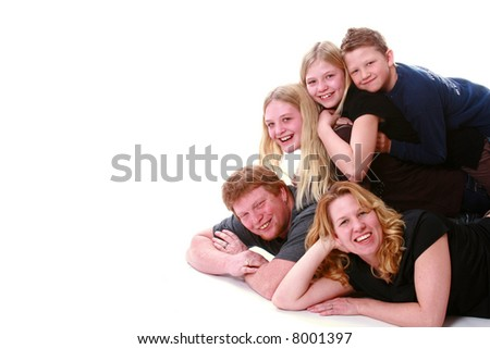 Family photo with everyone piled on top. - stock photo