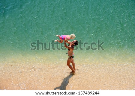 family play on a beach - stock photo