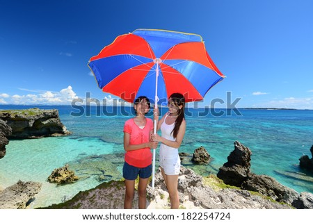Family playing at the beach - stock photo