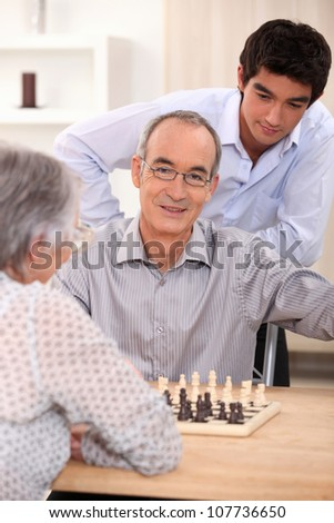 family playing chess - stock photo