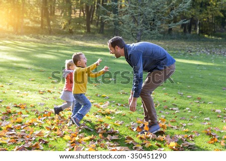 family playing in park - stock photo