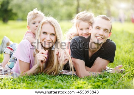 Family playing in the park on the grass
