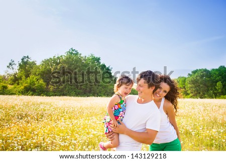 Family playing on the camomile meadow