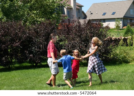 family playing outside in backyard - stock photo