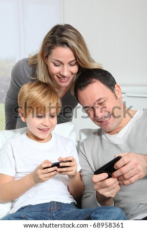 Family playing video game on smart-phone