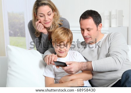 Family playing video game on smart phone