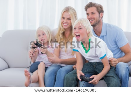 Family playing video games in the living room