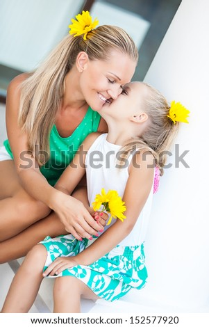 Family portrait cute little girl and cheerful mom - stock photo