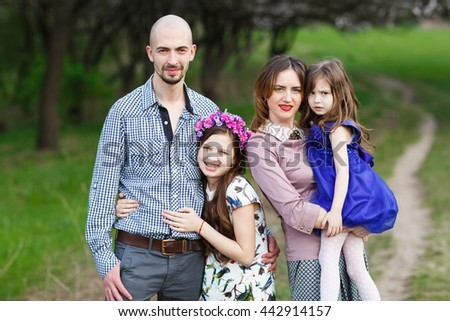 Family portrait in a park.