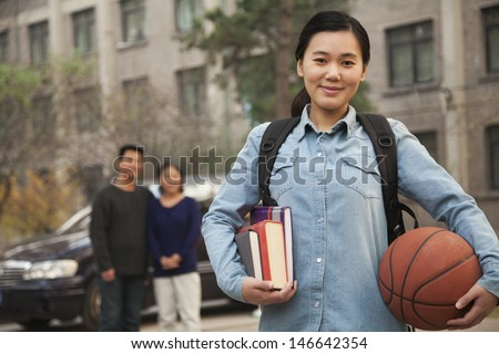 Family portrait in front of dormitory at college - stock photo