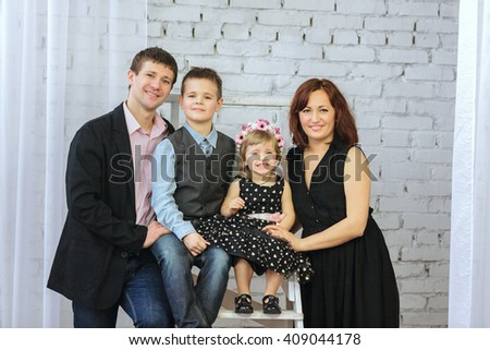 Family portrait in the studio - stock photo