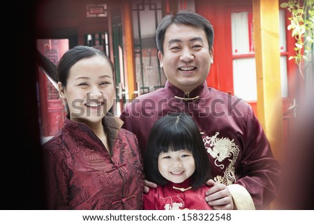 Family Portrait in traditional clothing - stock photo