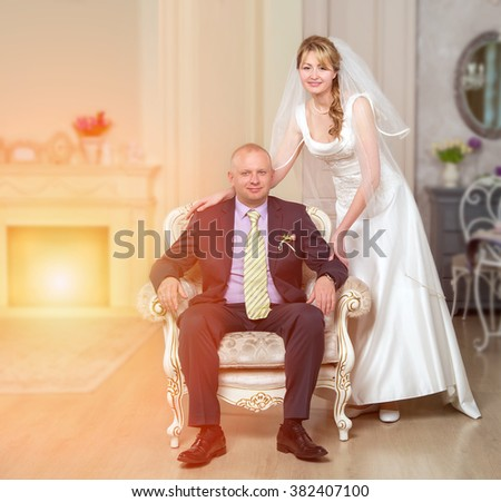 Family portrait newlyweds. Bride and groom. Wedding day. Adult man and woman bride and groom. Late marriages. Wedding unions. Marry after thirty. - stock photo