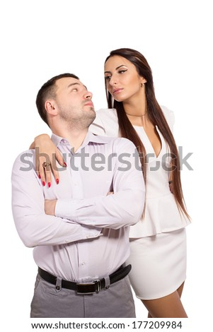 Family portrait of a modern young people. Man and woman wear a dress code. Complex family relationships. Woman dominates man. Love and hate each other simultaneously. Isolated. Mistrust. - stock photo