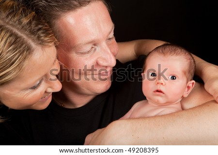 Family portrait of twenty days old baby with parents - stock photo
