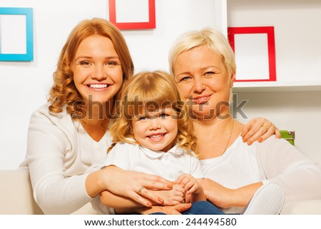 Family portrait with gril mother and granny - stock photo