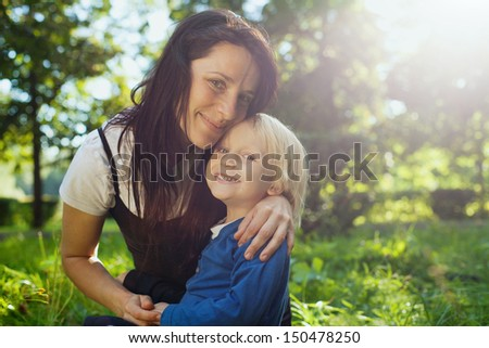family portrait with place for the text, young beautiful mother with cute child - stock photo