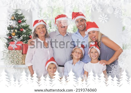 Family posing for photo against fir tree forest and snowflakes - stock photo