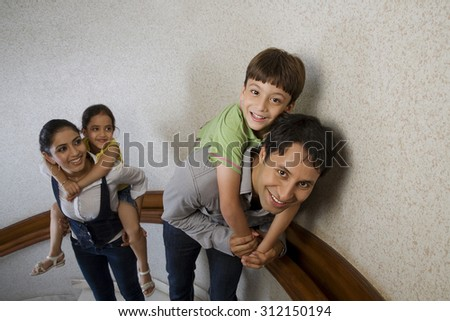 Family posing on the stairs