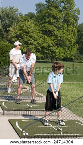 Family Practicing Golf - stock photo