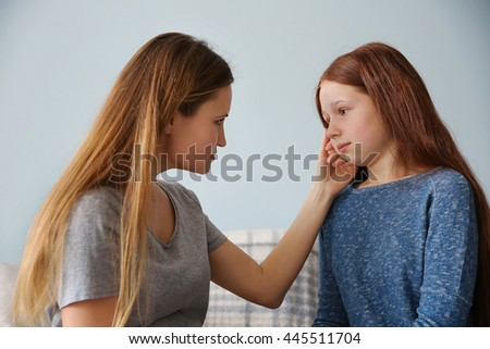 Family problems concept. Mother becalming girl