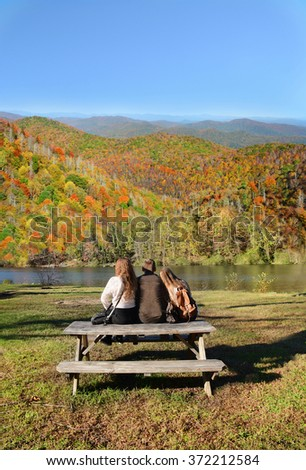 Family relaxing after hiking in autumn forest, North Carolina. - stock photo
