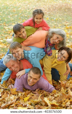 Family relaxing in autumn park - stock photo