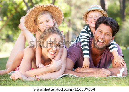 Family Relaxing In Park Together - stock photo
