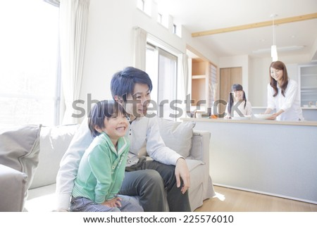 Family relaxing in the living room - stock photo