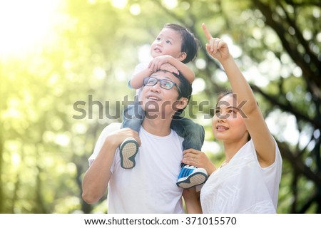 Family relaxing in the park - stock photo