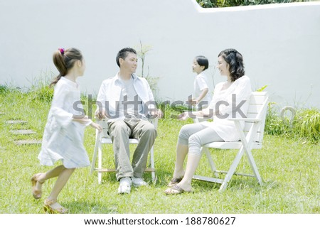 family relaxing on lawn