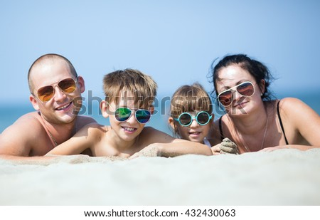 family resting on the sea