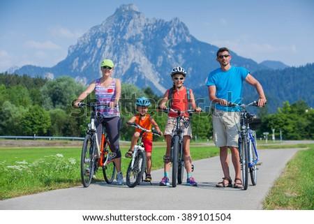 Family riding bikes - stock photo