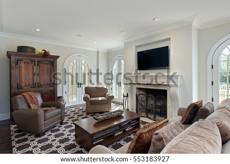 Family room in luxury home with fireplace.